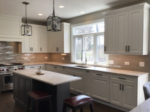 """kitchen island cabinetry is Décor in """"Cobblestone."""